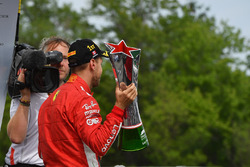 Race winner Sebastian Vettel, Ferrari celebrates on the podium with the trophy