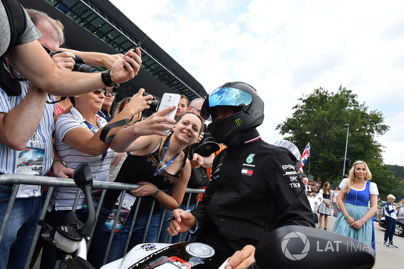 Lewis Hamilton, Mercedes-AMG F1 on his MV Agusta motorbike and fans selfie