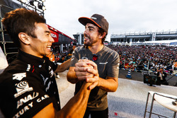 Takuma Sato on stage with Fernando Alonso, McLaren
