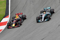 Max Verstappen, Red Bull Racing RB13 passes Lewis Hamilton, Mercedes-Benz F1 W08  for the lead