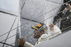 Race winner Lewis Hamilton, Mercedes AMG F1, sprays Champagne from the podium