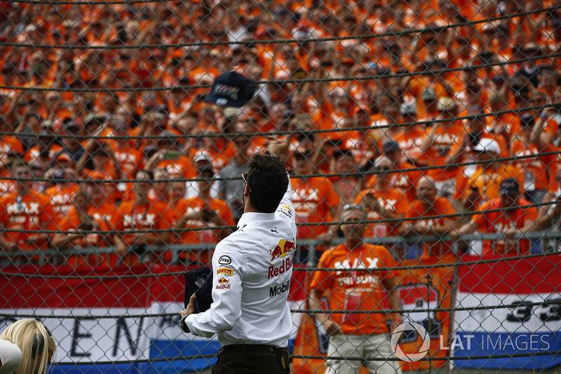Daniel Ricciardo, Red Bull Racing, throws a cap in to the crowd