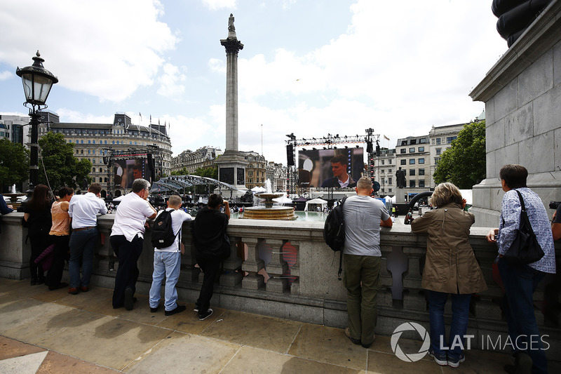 Fans watch the big screen entertainment across Trafalgar Square