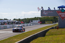 #75 SunEnergy1 Racing Mercedes AMG GT3, GTD: Kenny Habul, Mikael Grenier, Crosses the Finish Line under there checkered flag for the win.