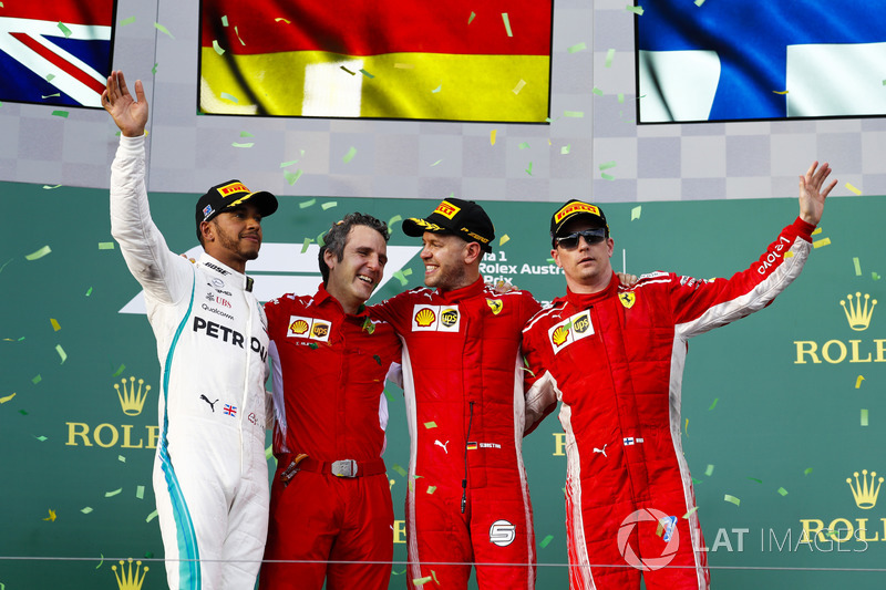 Lewis Hamilton, Mercedes AMG F1, 2nd position, Inaki Rueda, Race Strategist, Ferrari, Sebastian Vettel, Ferrari, 1st position, and Kimi Raikkonen, Ferrari, 3rd position, on the podium