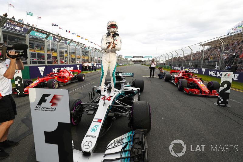 Lewis Hamilton, Mercedes AMG F1, celebrates taking pole position on the pit straight