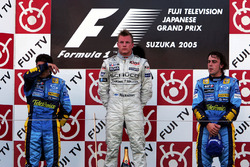 The podium: Giancarlo Fisichella, Renault, second; Kimi Raikkonen, McLaren, race winner; Fernando Alonso, Renault, third