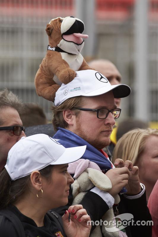A fan of Lewis Hamilton, Mercedes AMG F1, waits for an autograph