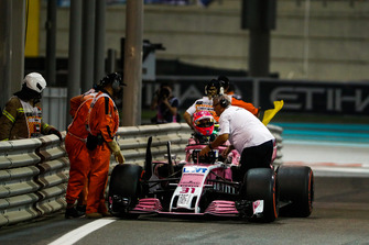 Marshals move the car of Esteban Ocon, Racing Point Force India VJM11, as he retires from the race with technical issues