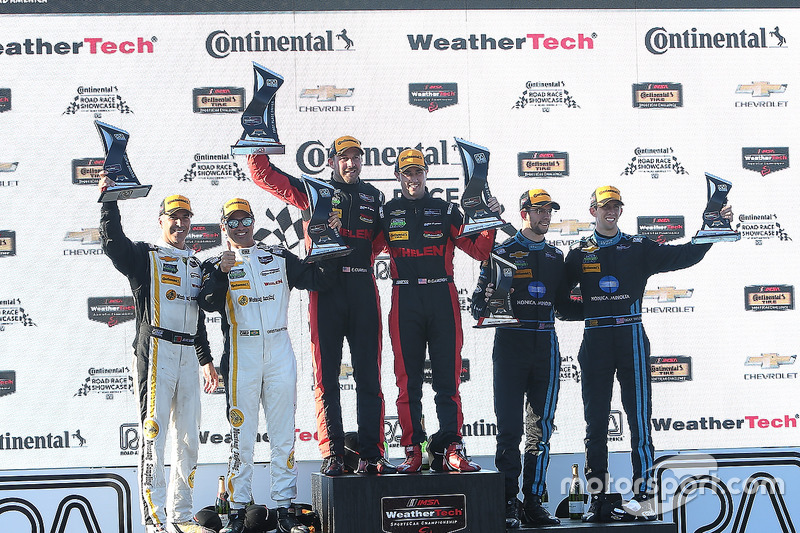Overall podium: winners Eric Curran, Dane Cameron, Action Express Racing, second place Christian Fittipaldi, Joao Barbosa, Action Express Racing, third place Ricky Taylor, Jordan Taylor, Wayne Taylor Racing