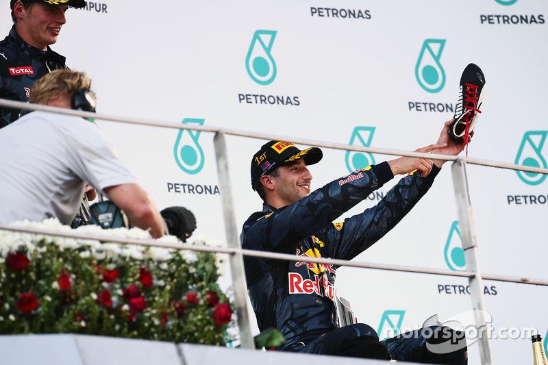 Race winner Daniel Ricciardo, Red Bull Racing celebrates on the podium with his race boot