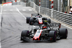 Kevin Magnussen, Haas F1 Team VF-18, leads Romain Grosjean, Haas F1 Team VF-18