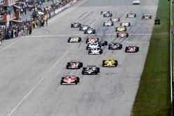 Gilles Villeneuve, Ferrari Ferrari 312T3 leads the original start of the race from pole sitter Mario Andretti, Lotus 79
