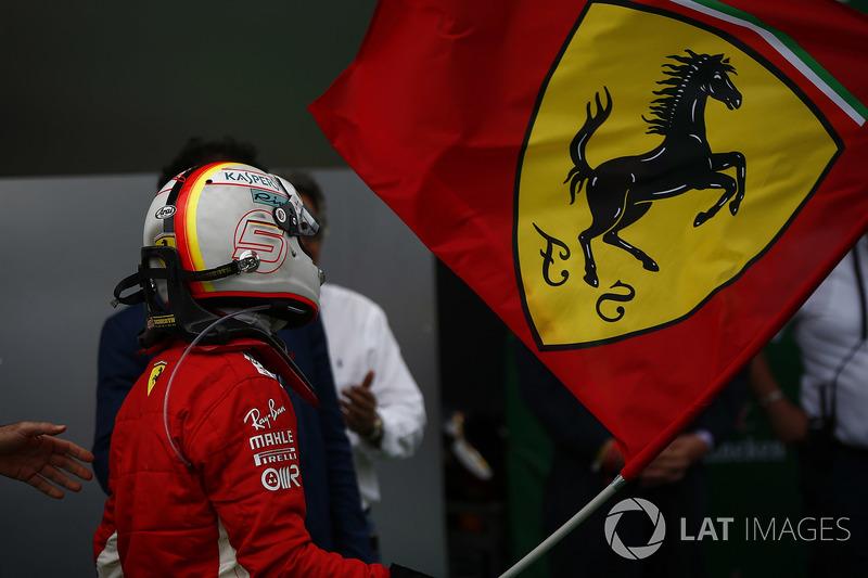 Sebastian Vettel, Ferrari, 1st position, waves the Ferrari flag in Parc Ferme