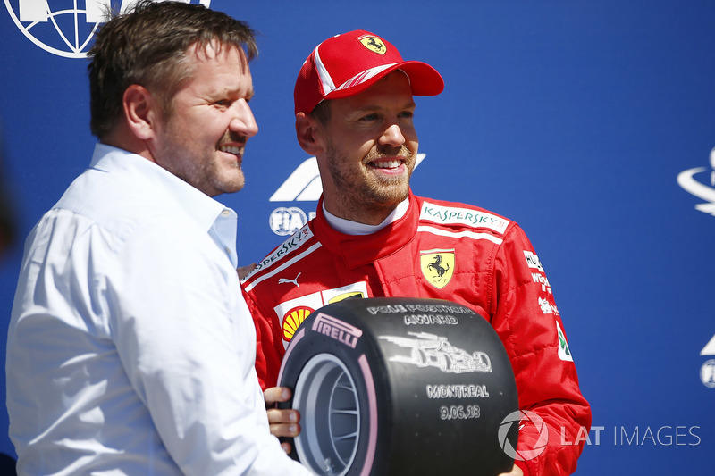 Paul Hembrey, Director, Pirelli Motorsport, presents Sebastian Vettel, Ferrari, with the Pirelli Pole Position Award