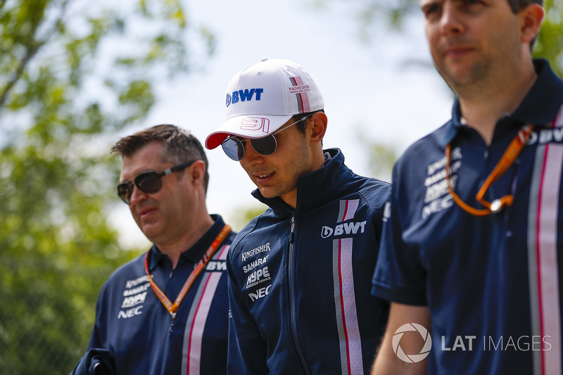 Esteban Ocon, Force India, walks the track with colleagues