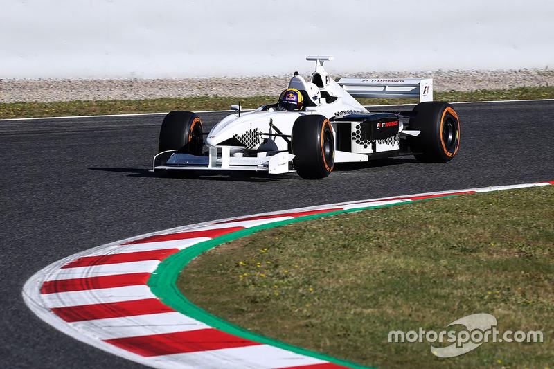 Пилот F1 Experiences Патрик Фризахер с пассажиром