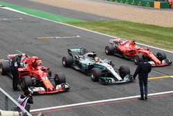 Kimi Raikkonen, Ferrari SF70H, Lewis Hamilton, Mercedes-Benz F1 W08  and Sebastian Vettel, Ferrari SF70H in parc ferme