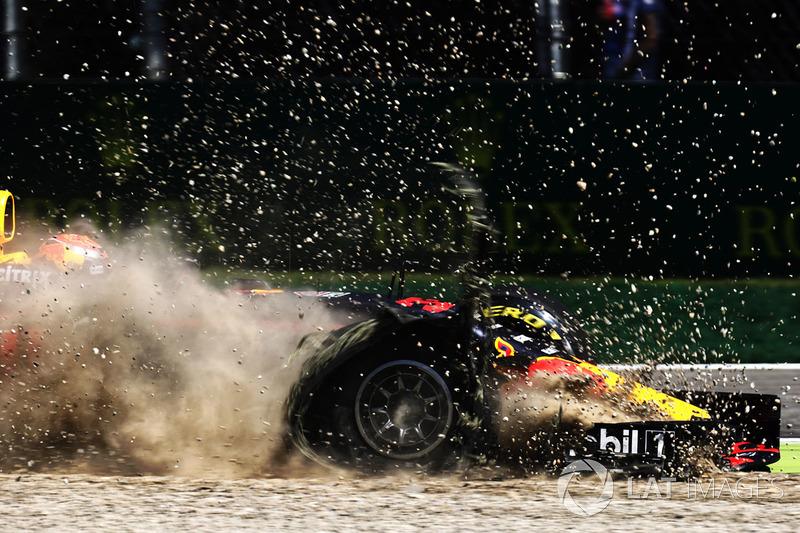 1.  Max Verstappen, Red Bull Racing RB13, in the gravel