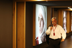 Chase Carey, Chairman, Formula One, walks past a portrait of Ayrton Senna