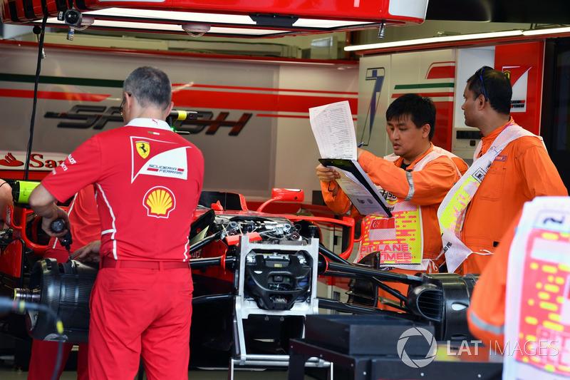 Ferrari SF70H in the garage and Scrutineers