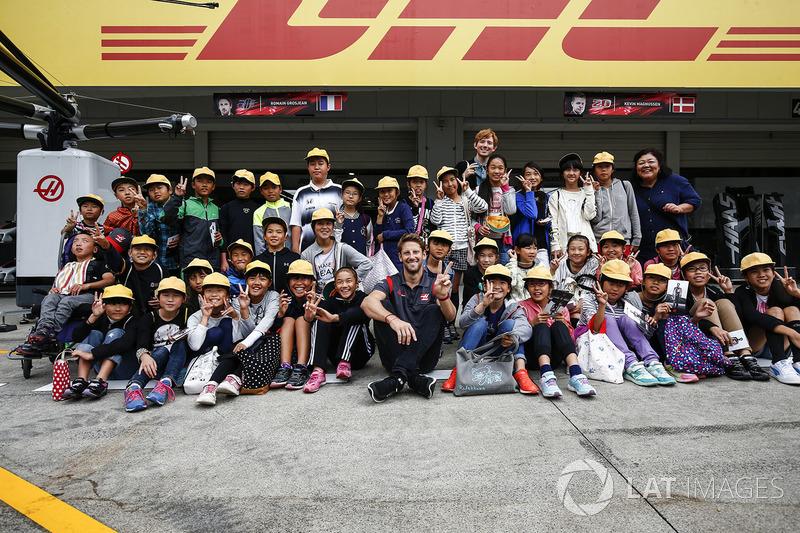 Romain Grosjean, Haas F1 Team, meets some fans in the pit lane