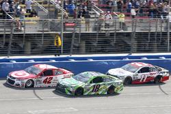 Kyle Larson, Chip Ganassi Racing Chevrolet leads Kyle Busch, Joe Gibbs Racing Toyota and Denny Hamlin, Joe Gibbs Racing Toyota on a late restart