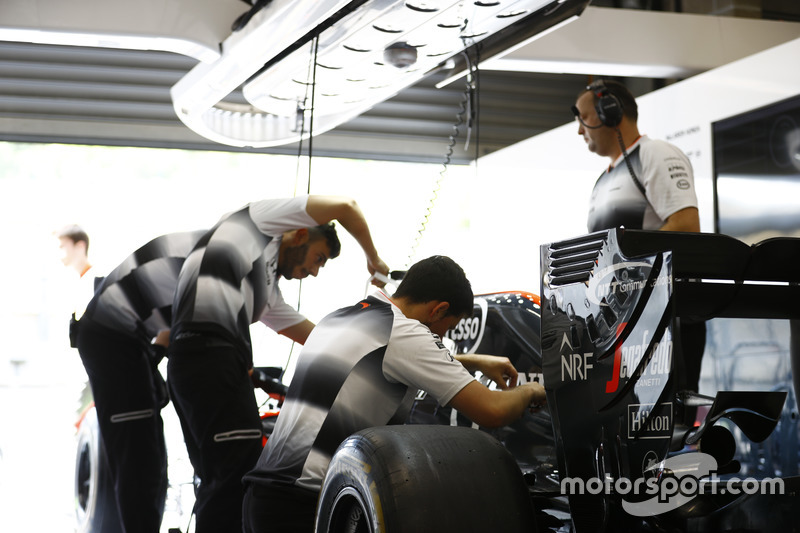 McLaren team members at work in the garage