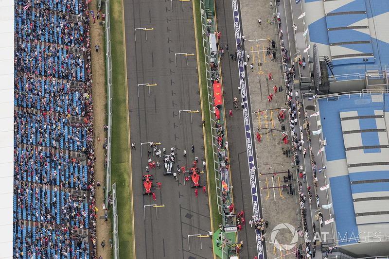 Top three qualifiers Lewis Hamilton, Mercedes AMG F1 W09, Sebastian Vettel, Ferrari SF71H, and Kimi Raikkonen, Ferrari SF71H, on the main straight after the Qualifying session