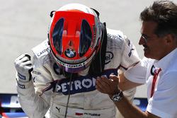 Mario Theissen, Director, BMW Motorsport, winner Robert Kubica, BMW Sauber F1.08