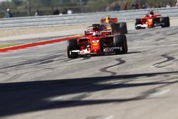 Sebastian Vettel, Ferrari SF70H, crosses the line ahead of Max Verstappen, Red Bull Racing RB13, Kimi Raikkonen, Ferrari SF70H
