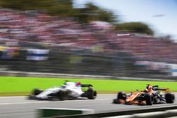 Stoffel Vandoorne, McLaren MCL32, passes Felipe Massa, Williams FW40