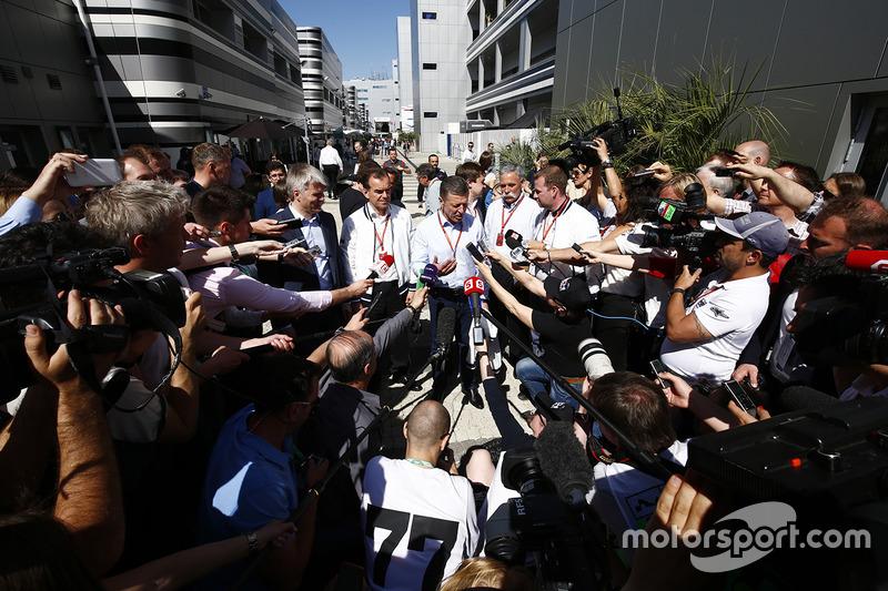 The media gather around Russian Prime Minister Dmitry Medvedev