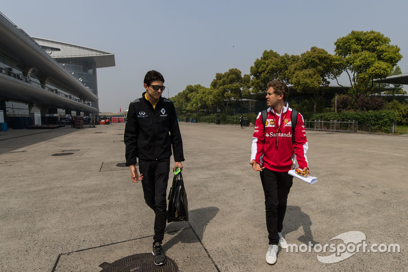 Estaben Ocon y Sebastian Vettel