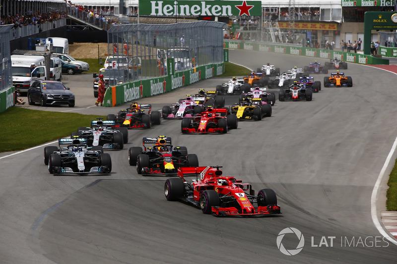 Sebastian Vettel, Ferrari SF71H leads Max Verstappen, Red Bull Racing RB14, Max Verstappen, Red Bull