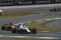 Sergey Sirotkin, Williams FW41 and Nico Hulkenberg, Renault Sport F1 Team R.S. 18