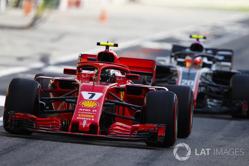 Kimi Raikkonen, Ferrari SF71H, leads Kevin Magnussen, Haas F1 Team VF-18 Ferrari