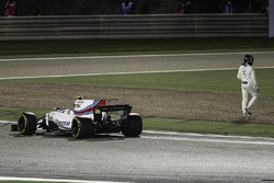 Lance Stroll, Williams FW40, climbs out of his car and walks away after a collision with Carlos Sainz Jr., Toro Rosso