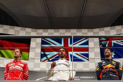 Race winner Lewis Hamilton, Mercedes AMG F1, second place Sebastian Vettel, Ferrari, third place Daniel Ricciardo, Red Bull Racing