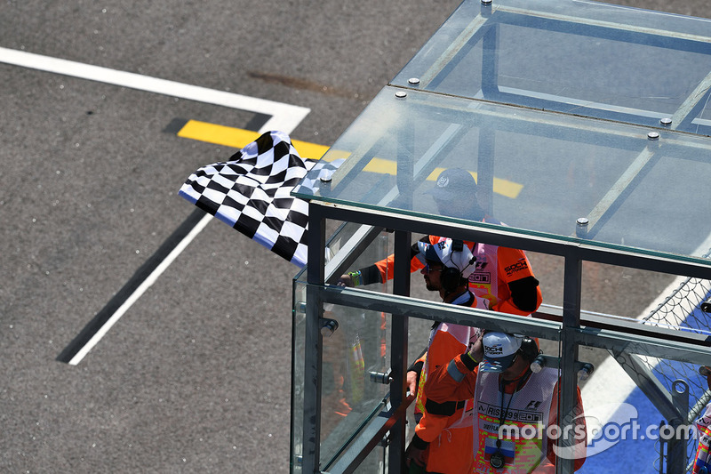 Chequered flag is waved