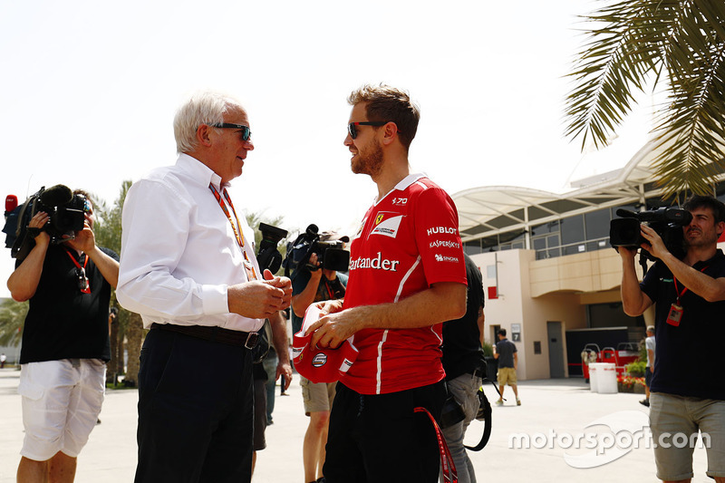 Sebastian Vettel, Ferrari, talks with Charlie Whiting, FIA Race Director