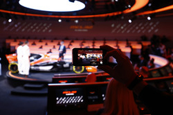 Race drivers Stoffel Vandoorne and Fernando Alonso on stage with presenter Simon Lazenby at the launch of the McLaren MCL32. A guest films the unveiling