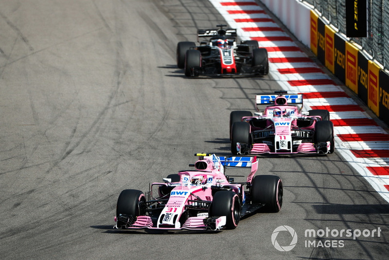 Esteban Ocon, Racing Point Force India VJM11, leads Sergio Perez, Racing Point Force India VJM11, and Romain Grosjean, Haas F1 Team VF-18
