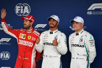 (L to R): Sebastian Vettel, Ferrari, Lewis Hamilton, Mercedes AMG F1 and Valtteri Bottas, Mercedes AMG F1 celebrate in Parc Ferme