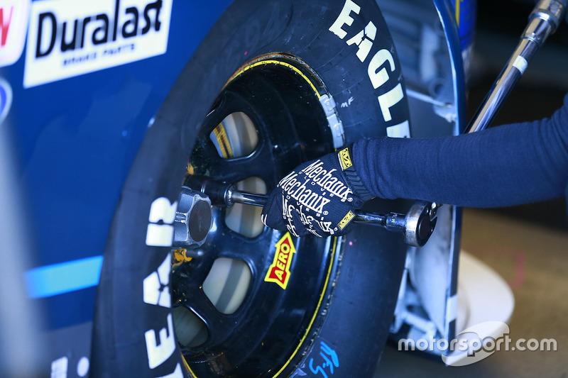 A mechanic torquing a wheel