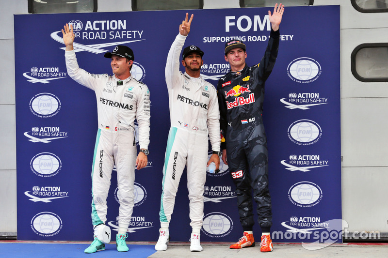 Qualifying top three in parc ferme: Nico Rosberg, Mercedes AMG F1, second; Lewis Hamilton, Mercedes