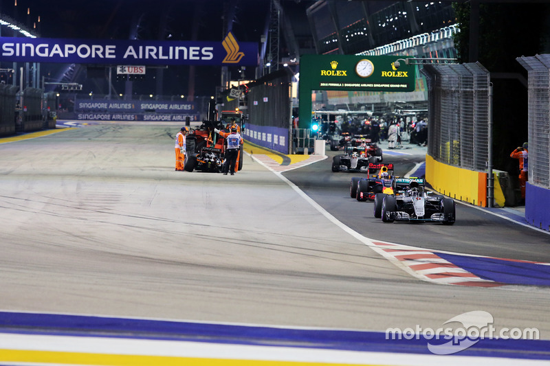 Nico Rosberg, Mercedes AMG F1 W07 Hybrid leads behind the FIA Safety Car as the Sahara Force India F1 VJM09 of Nico Hulkenberg, is removed from the circuit