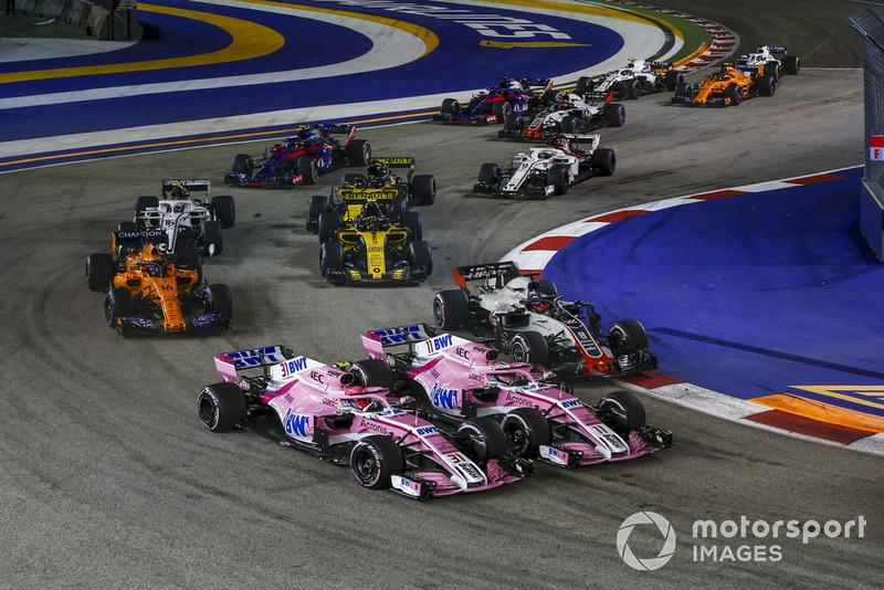 Esteban Ocon, Racing Point Force India VJM11, Sergio Perez, Racing Point Force India VJM11 y Romain Grosjean, Haas F1 Team VF-18