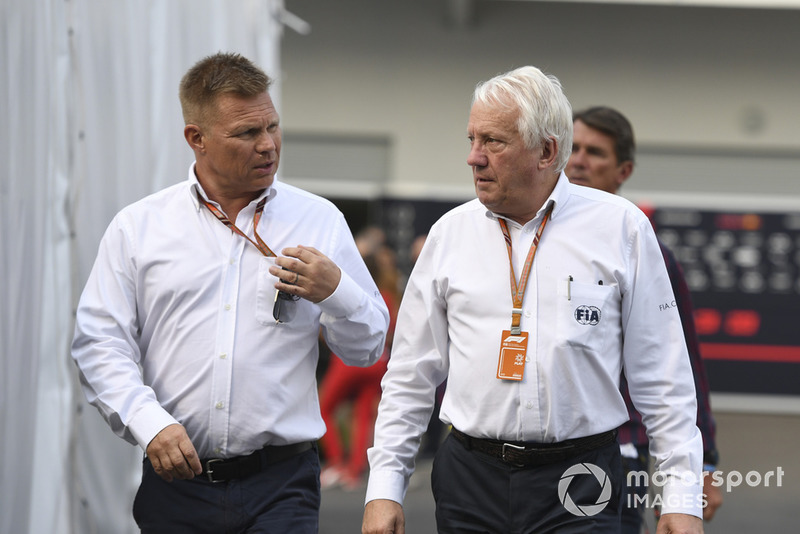 Mika Salo and Charlie Whiting, FIA Delegate