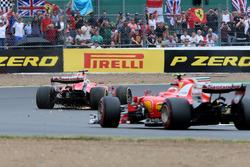 Sebastian Vettel, Ferrari SF70H, with a puncture and Kimi Raikkonen, Ferrari SF70H